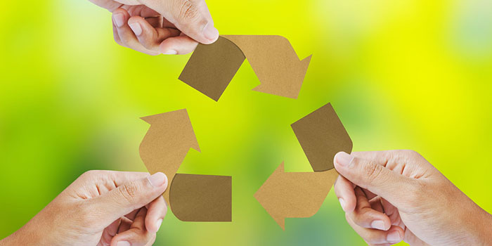 Recycling icon hands holding