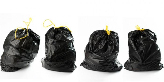 Four full garbage bags