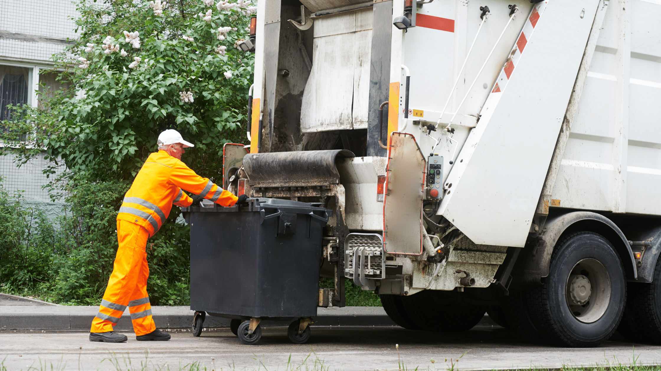 image showing dumpster about to be emptied into packer garbage truck