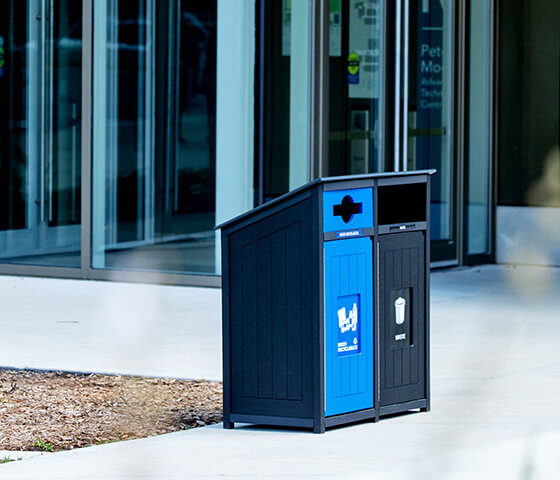 Busch Systems Aspyre Collection Aura Series double in black and blue at a municipal building entrance outside
