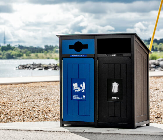 Busch Systems Aspyre Collection Aura Series double in black and blue at a city waterfront outside