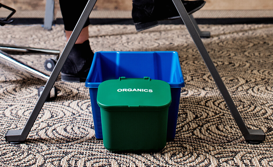 Busch Systems Deskside Recycler container in blue with green organics hanging waste basket attached