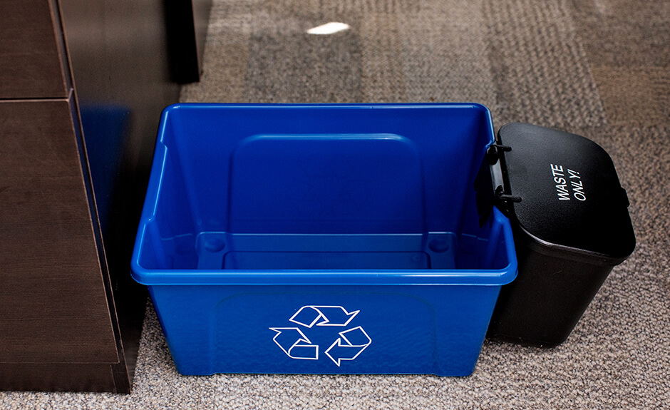 Busch Systems Deskside Recycler container in blue with black hanging waste basket attached