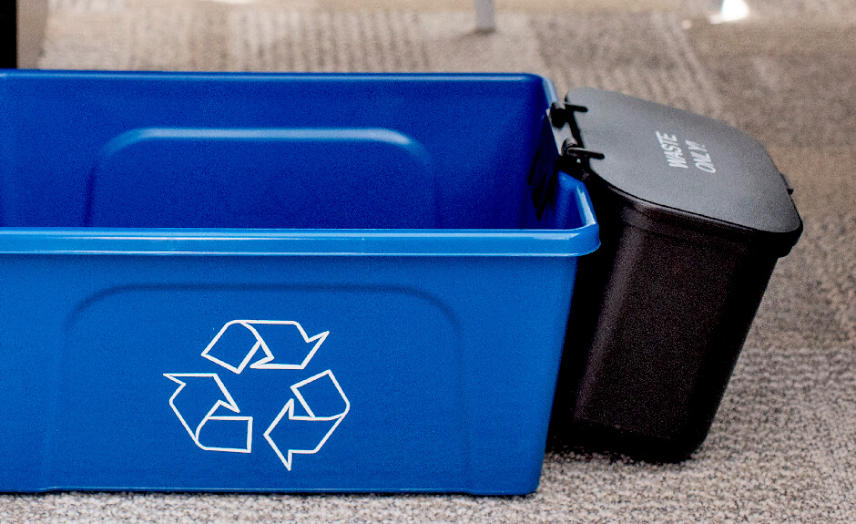 Busch Systems Deskside Recycler container in blue with mobius loop graphic and black hanging waste basket