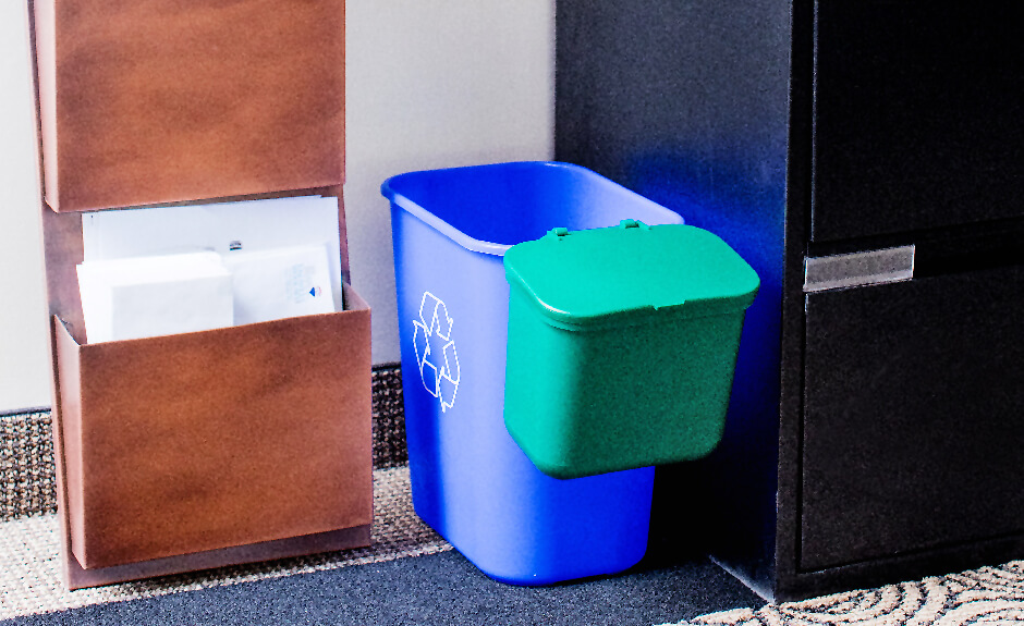 Busch Systems Recycling container in blue with mobius loop graphic and green hanging waste basket